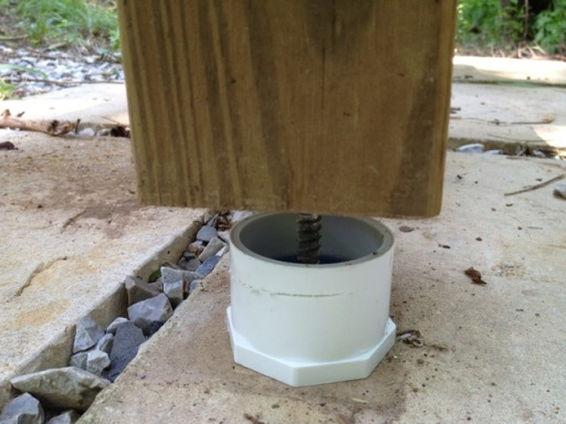 Close up view of PVC caps installed at the bottom of a hive stand (image courtesy of Chuck Schwalbe of the FCBA)